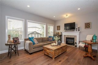 Photo 3: 702 CANOE Avenue SW: Airdrie Detached for sale : MLS®# C4287194