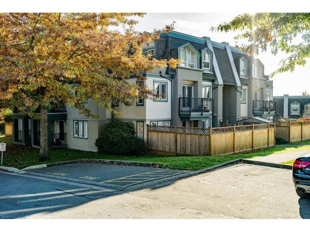 "Main Photo: 90 211 BEGIN Street in Coquitlam: Maillardville Townhouse for sale in ""FONTAINE BLEU"" : MLS®# R2538767"
