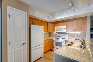 Photo 8: 406 300 Edwards Way NW: Airdrie Apartment for sale : MLS®# A1071313