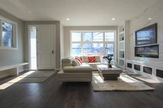 Photo 2: 2410 54 Avenue SW in Calgary: North Glenmore Park Semi Detached for sale : MLS®# A1082680