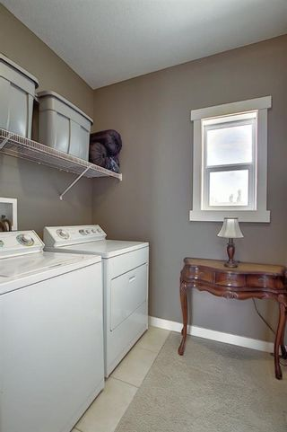 Photo 31: 47 WEST SPRINGS Lane SW in Calgary: West Springs Row/Townhouse for sale : MLS®# A1039919