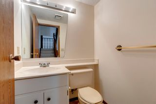 Photo 8: 100 23 Glamis Drive SW in Calgary: Glamorgan Row/Townhouse for sale : MLS®# A1056750