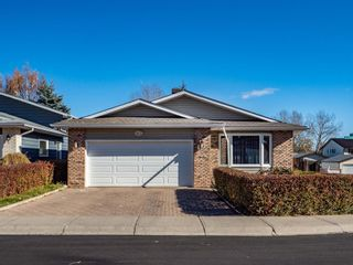 Main Photo: 112 Woodmont Drive SW in Calgary: Woodbine Detached for sale : MLS®# A1154719