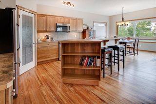 Photo 7: 244 SUNSET Close: Cochrane Detached for sale : MLS®# C4305760