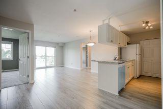 "Photo 1: 209 33960 OLD YALE Road in Abbotsford: Central Abbotsford Condo for sale in ""OLD YALE HEIGHTS"" : MLS®# R2480632"
