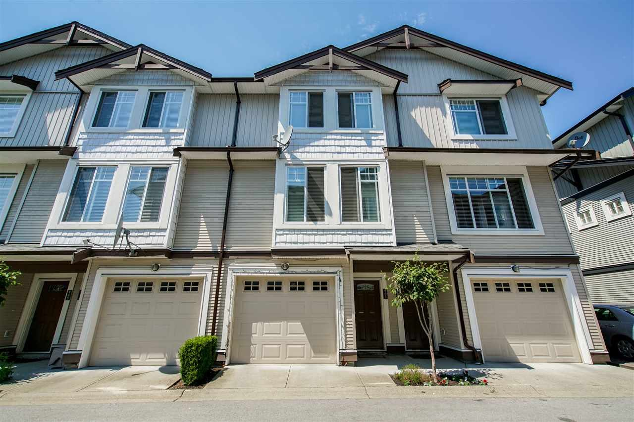 Main Photo: 63 7156 144 Street in Surrey: East Newton Townhouse for sale : MLS®# R2357612