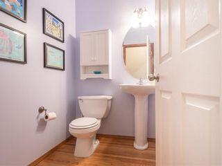 Photo 9: 208 WEST TERRACE Place: Cochrane House for sale : MLS®# C4192643