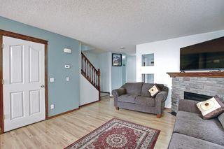Photo 5: 507 CRANSTON Drive SE in Calgary: Cranston Semi Detached for sale : MLS®# A1096258