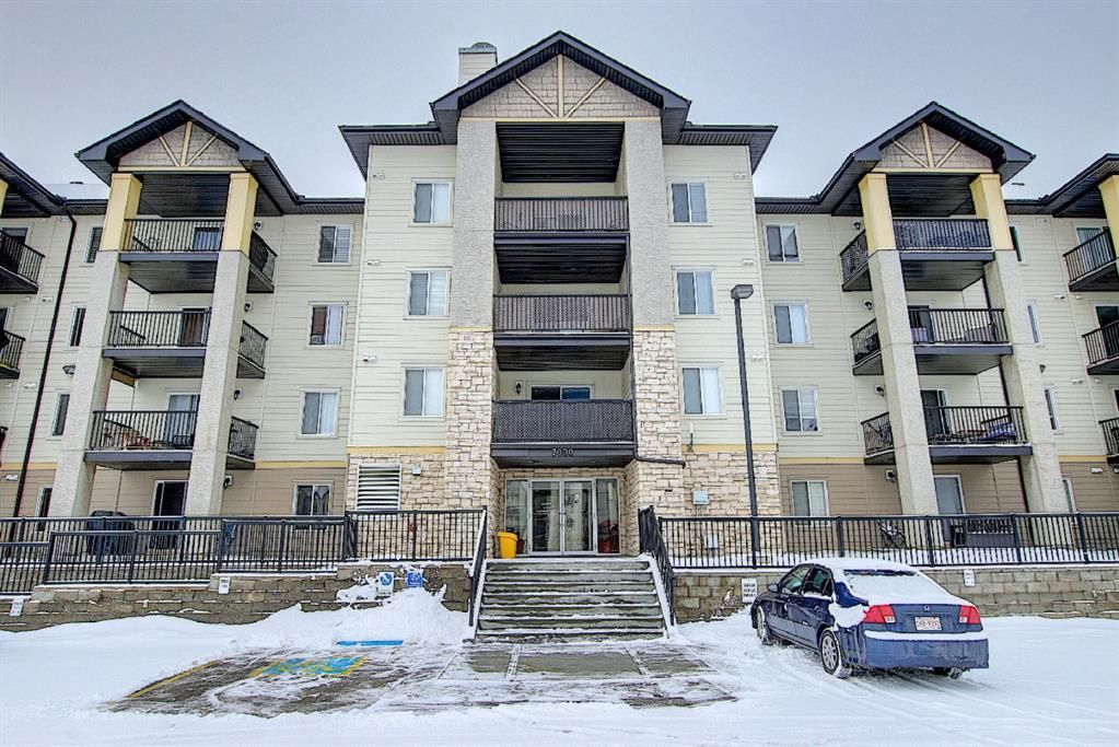Main Photo: 7402 304 MacKenzie Way SW: Airdrie Apartment for sale : MLS®# A1081028