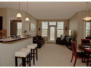 Photo 2: 211 1 Crystal Green Lane: Okotoks Condo for sale : MLS®# C3612012