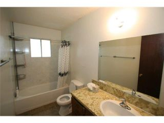 Photo 11: 7712 HUNTERVIEW Drive NW in CALGARY: Huntington Hills 4Plex for sale (Calgary)  : MLS®# C3630605