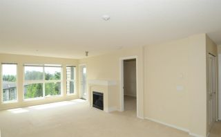 """Photo 6: 202 3082 DAYANEE SPRINGS Boulevard in Coquitlam: Westwood Plateau Condo for sale in """"The Lanterns"""" : MLS®# R2589726"""