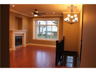 Photo 5: 7657 DAVIES Street in Burnaby: Edmonds BE House for sale (Burnaby East)  : MLS®# V928171