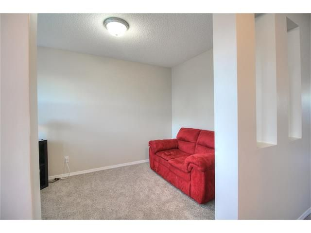 Photo 7: Photos: 606 EVERMEADOW Road SW in Calgary: Evergreen House for sale : MLS®# C4053479