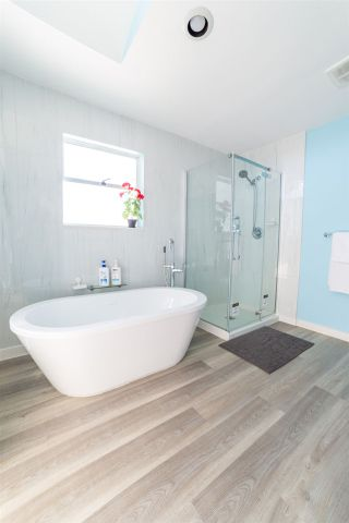 Photo 10: 4899 MOSS Street in Vancouver: Collingwood VE House for sale (Vancouver East)  : MLS®# R2566068