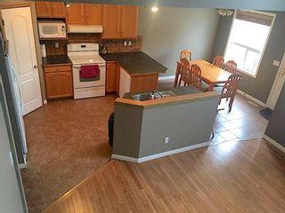 Photo 5: 13014 Douglas Ridge Grove SE in Calgary: Douglasdale/Glen Detached for sale : MLS®# A1090823