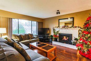 "Photo 2: 7387 142 Street in Surrey: East Newton House for sale in ""Nichol Creek Estates"" : MLS®# R2228884"