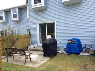 Photo 3: 108 4810 40 Avenue SW in Calgary: Glamorgan Row/Townhouse for sale : MLS®# A1060323