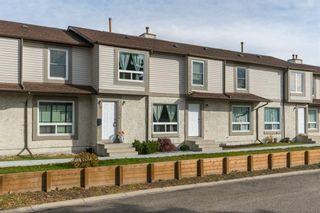 Main Photo: 230 Deerpoint SE in Calgary: Deer Ridge Row/Townhouse for sale : MLS®# A1157307