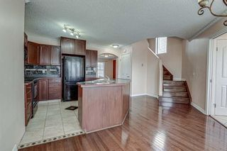 Photo 13: 64 Eversyde Circle SW in Calgary: Evergreen Detached for sale : MLS®# A1090737