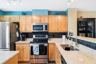 Photo 11: 206 TOSCANA Gardens NW in Calgary: Tuscany Row/Townhouse for sale : MLS®# A1088865