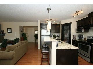 Photo 8: 1857 BAYWATER Street SW: Airdrie House for sale : MLS®# C4104542