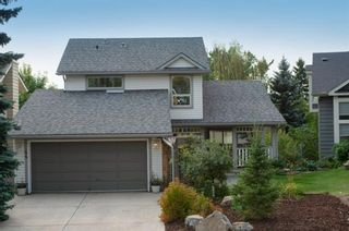 Photo 1: 44 Strathlorne Crescent SW in Calgary: Strathcona Park Detached for sale : MLS®# A1145486
