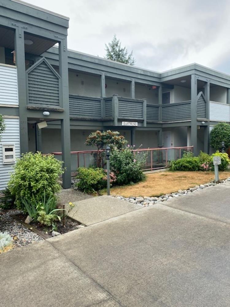 Main Photo: 111 5780 TRAIL Avenue in Sechelt: Sechelt District Condo for sale (Sunshine Coast)  : MLS®# R2607897