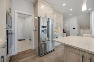 Photo 6: 69 Westpoint Way SW in Calgary: West Springs Detached for sale : MLS®# A1153567