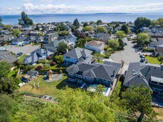 "Main Photo: 403 SEASHELL Drive in Delta: Boundary Beach House for sale in ""CENTENNIAL TIDES"" (Tsawwassen)  : MLS®# R2565059"