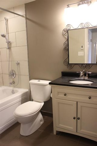 Photo 19: 4312 Amiens Road SW in Calgary: Garrison Woods Semi Detached for sale : MLS®# A1144342