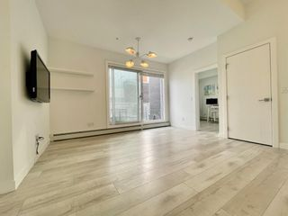 Photo 5: 310 3130 Thirsk Street NW in Calgary: University District Apartment for sale : MLS®# A1076125