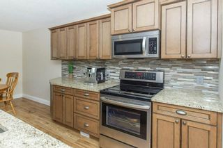 Photo 7: 67 CRYSTALRIDGE Close: Okotoks House for sale : MLS®# C4139446