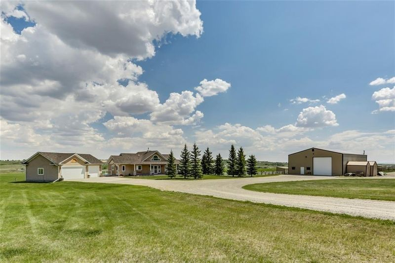 FEATURED LISTING: Okotoks 119 acres,home, shop,barn Street West Rural Foothills County