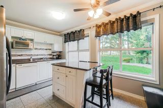 "Photo 7: 106 7435 121A Street in Surrey: West Newton Condo for sale in ""Strawberry Hills Estates"" : MLS®# R2422525"