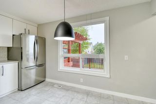 Photo 8: 215 Strathearn Crescent SW in Calgary: Strathcona Park Detached for sale : MLS®# A1146284