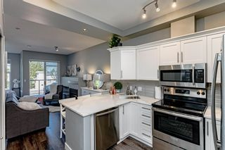 """Photo 18: #407 20200 56 Avenue in Langley: Langley City Condo for sale in """"The Bentley"""" : MLS®# R2598723"""