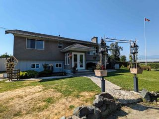 Photo 1: 46553 MONTANA Drive in Chilliwack: Fairfield Island House for sale : MLS®# R2597658