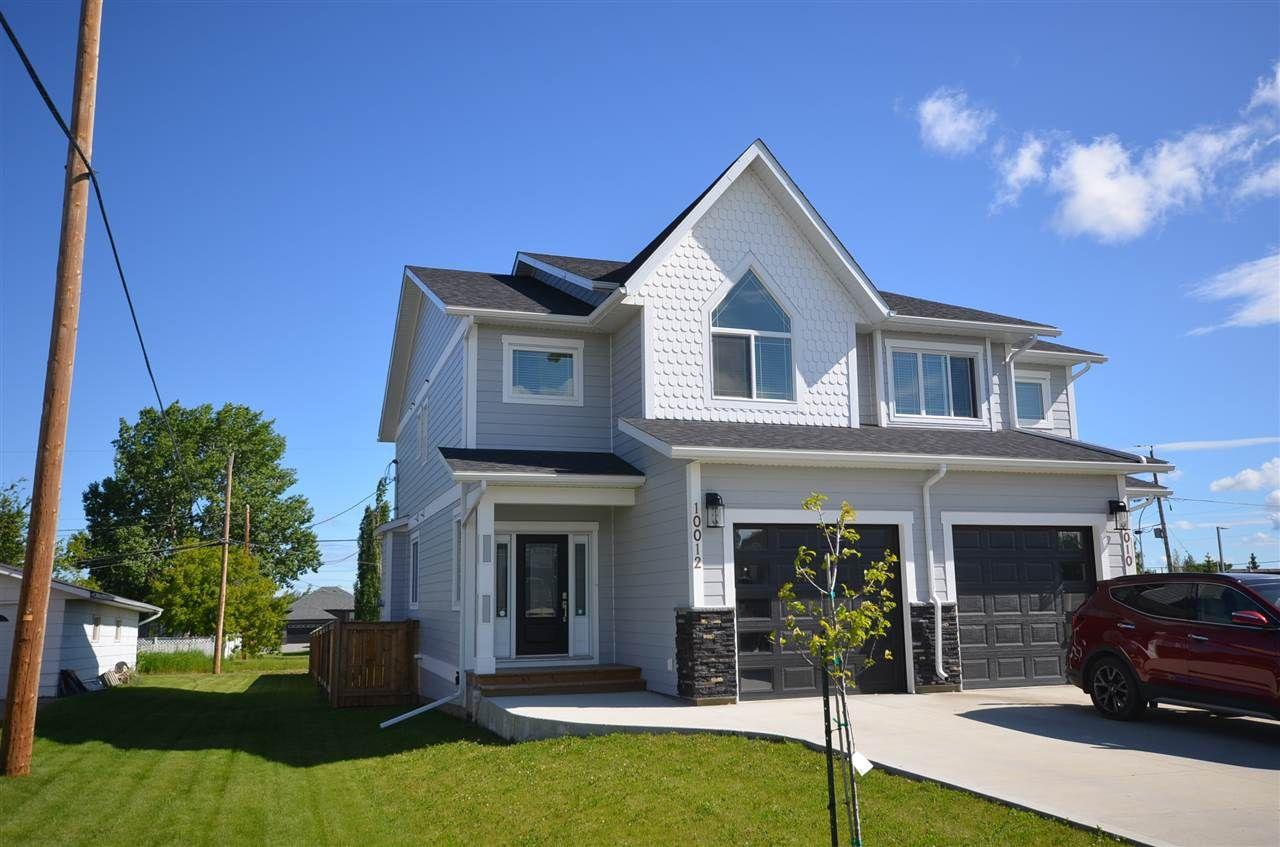 Main Photo: 10012 111 Avenue in Fort St. John - Rural W 100th: Fort St. John - City NW 1/2 Duplex for sale (Fort St. John (Zone 60))  : MLS®# R2469597