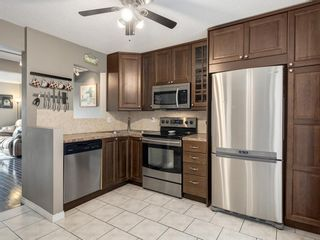Photo 9: 8 220 ERIN MOUNT Crescent SE in Calgary: Erin Woods Row/Townhouse for sale : MLS®# A1088896