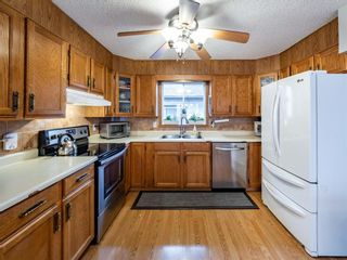 Photo 11: 215 Millcrest Way SW in Calgary: Millrise Detached for sale : MLS®# A1103784