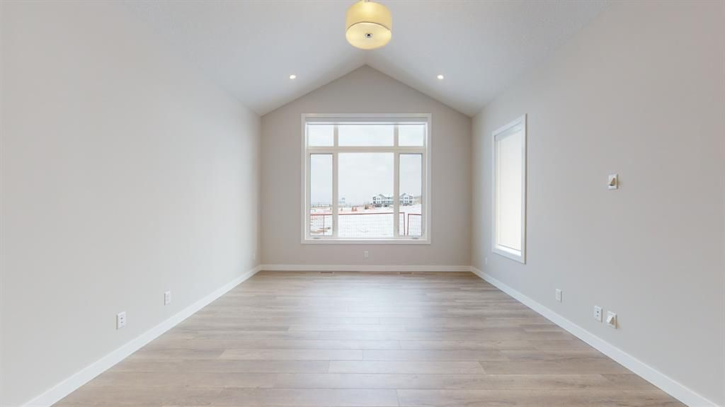 Photo 18: Photos: 38 Crestridge Bay SW in Calgary: Crestmont Row/Townhouse for sale : MLS®# A1073636