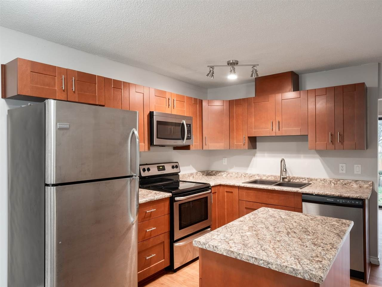 """Main Photo: 3234 GANYMEDE Drive in Burnaby: Simon Fraser Hills Townhouse for sale in """"SIMON FRASER VILLAGE"""" (Burnaby North)  : MLS®# R2328379"""