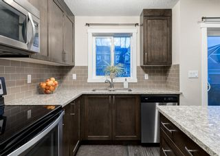 Photo 8: 102 2400 RAVENSWOOD View SE: Airdrie Row/Townhouse for sale : MLS®# A1092501