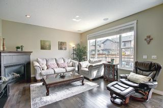 Photo 9: 47 ASPENSHIRE Drive SW in Calgary: Aspen Woods Detached for sale : MLS®# A1106772