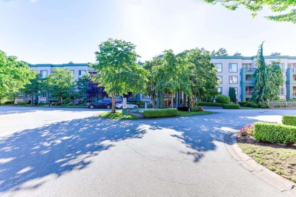 Main Photo: 310 13860 70 Avenue in Surrey: East Newton Condo for sale : MLS®# R2593741