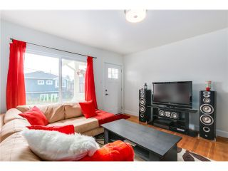 """Photo 2: 5105 RUBY Street in Vancouver: Collingwood VE House for sale in """"Collingwood"""" (Vancouver East)  : MLS®# V1082069"""