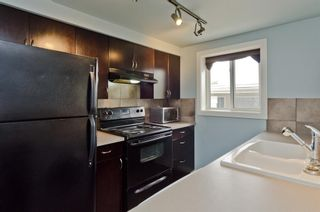 Photo 3: 6 609 67 Avenue SW in Calgary: Kingsland Apartment for sale : MLS®# A1077068