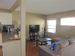 Photo 4: 37 MILLVIEW Green SW in Calgary: Millrise House for sale : MLS®# C4015611