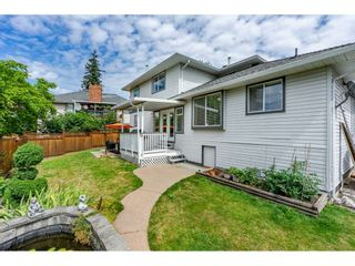"""Photo 4: 6495 180 Street in Surrey: Cloverdale BC House for sale in """"Orchard Ridge"""" (Cloverdale)  : MLS®# R2396953"""